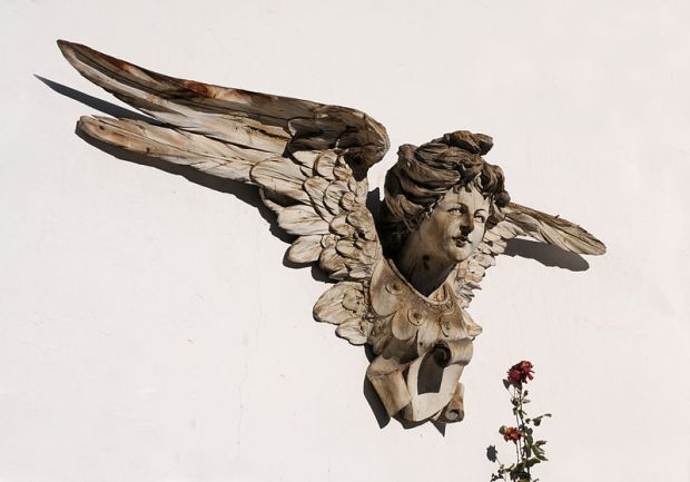 Beautiful carved wooden angel - photo by Wolfgang Moroder